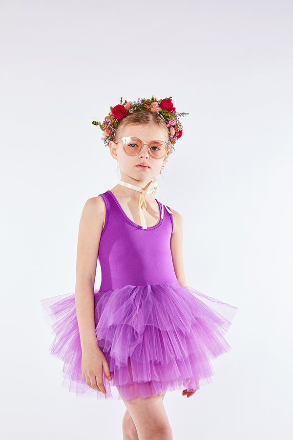 Iloveplum girls 'Aleia' purple tutu features a classic leotard body, a spandex racerback bodice adorned with snap closures and tons of tulle to twirl in.