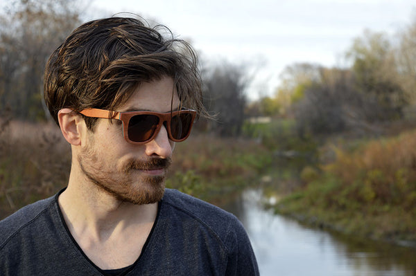 male model wearing brown skateboard wood sunglasses