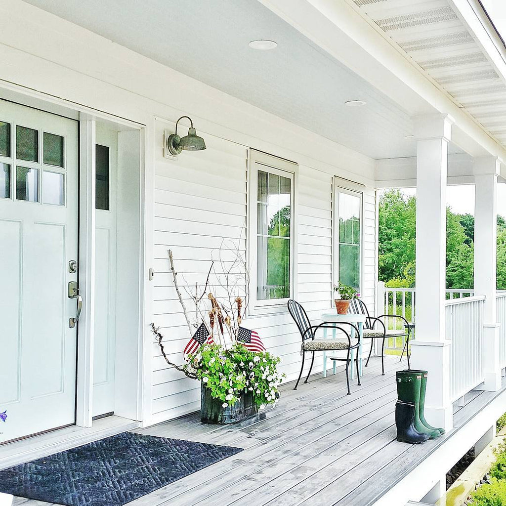 White Farmhouse Front Porch with Light Blue Door