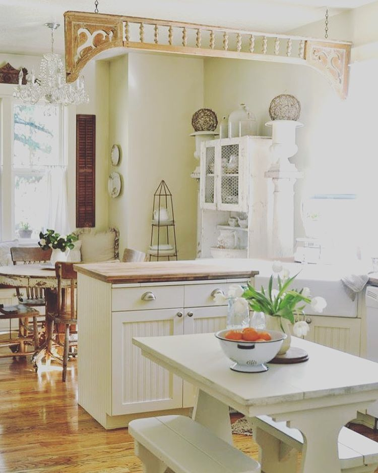 Cottage Farmhouse Kitchen with White Cabinets and Butcher Block Wood Countertops
