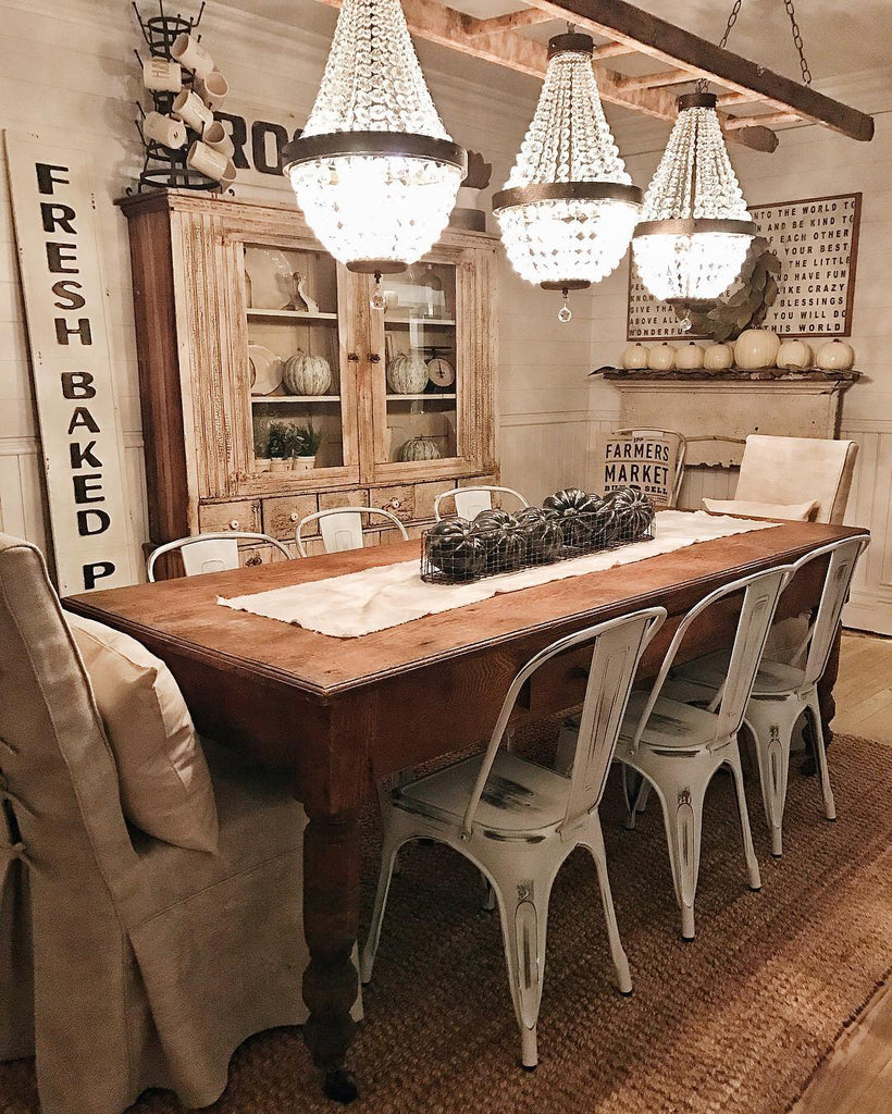 Rustic Glam Farmhouse Dining Room with Crystal Chandeliers and Antique China Hutch