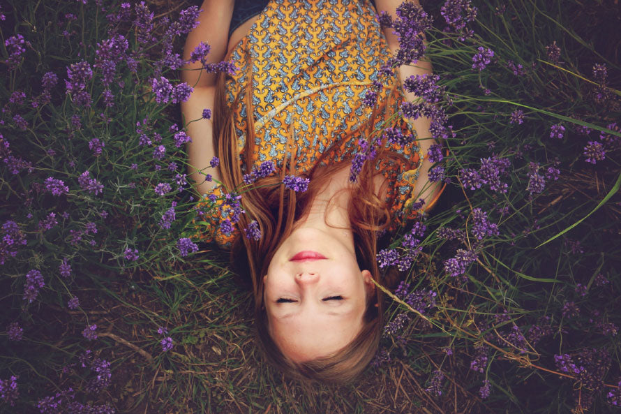 Women laying in feild of lavendar