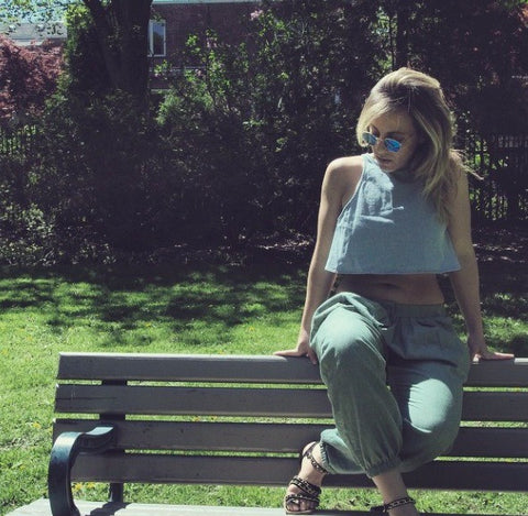 blonde woman on park bench