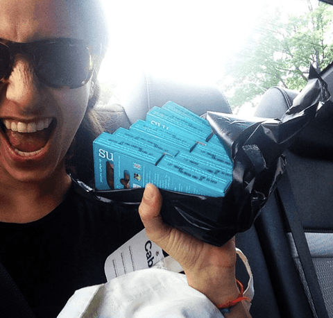 Meika holding Sustain condoms