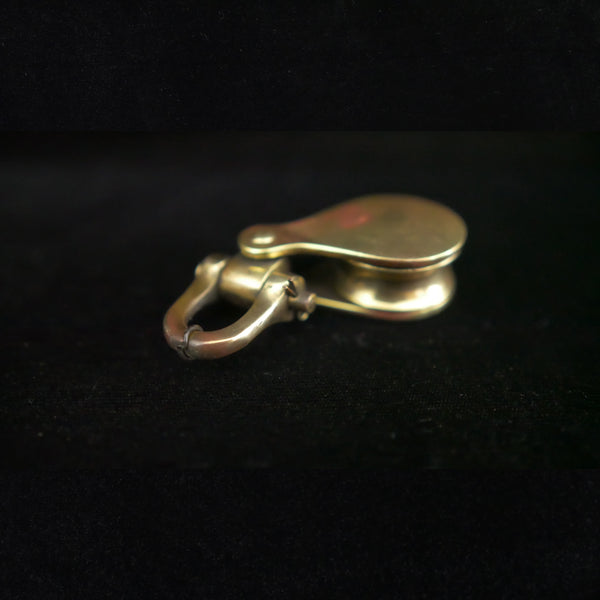 Antique brass marine block with snap shackle.