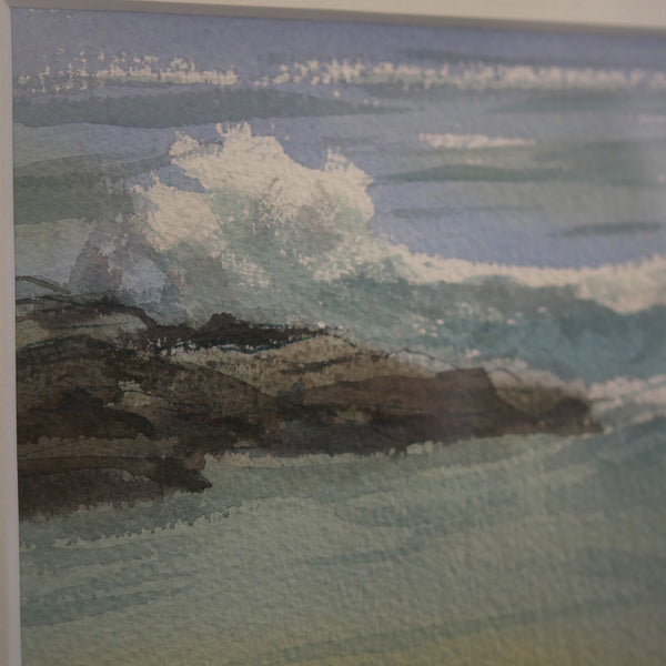 Detail showing the waves crashing on the rocks.