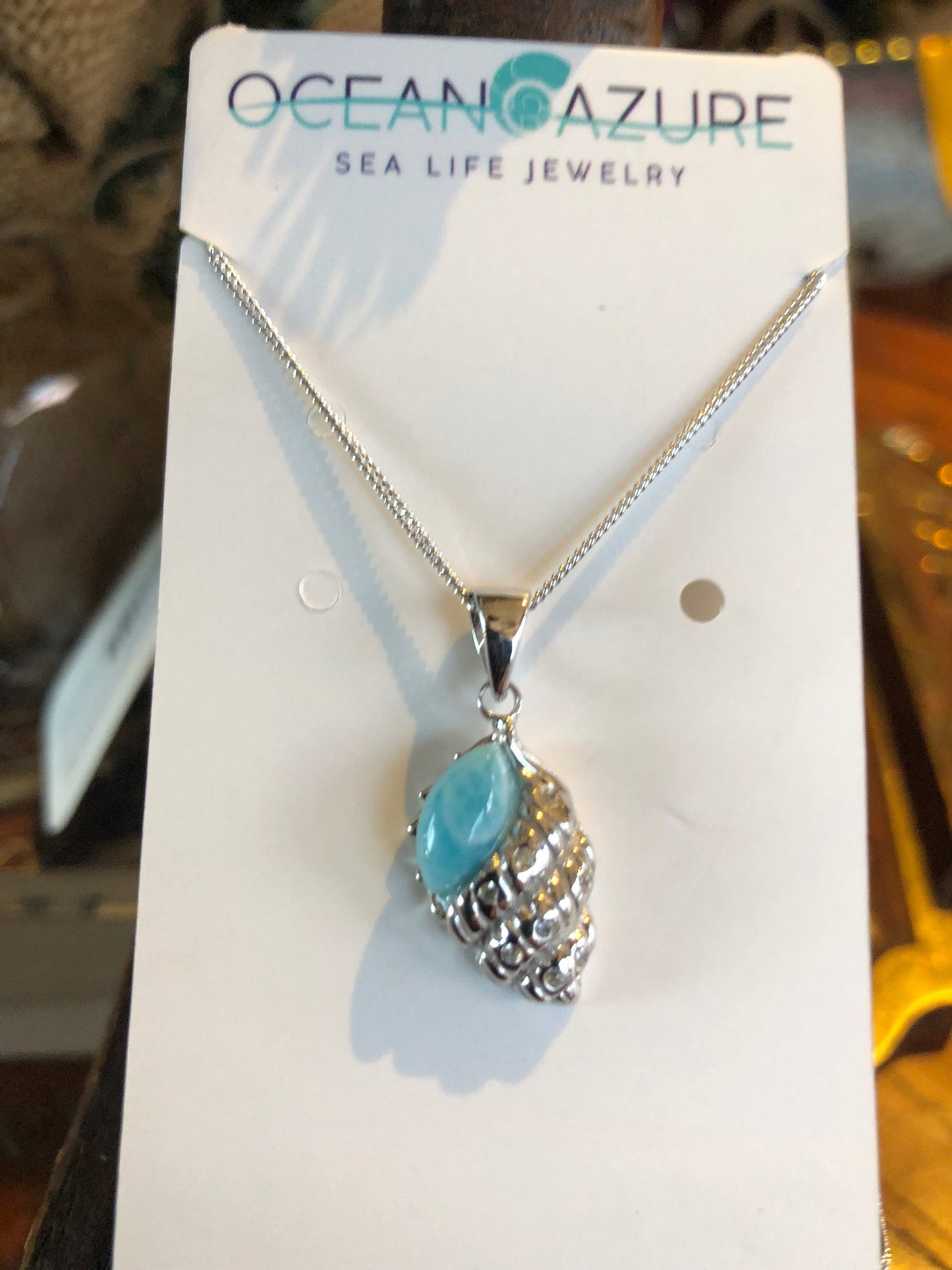 Necklace, Waved Welk Pendant, Sterling Silver with Larimar Stone