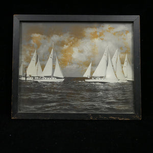 Vintage antique photograph of sailboats in the water.