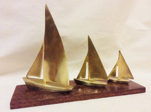Sailboats, three brass on cherry stand