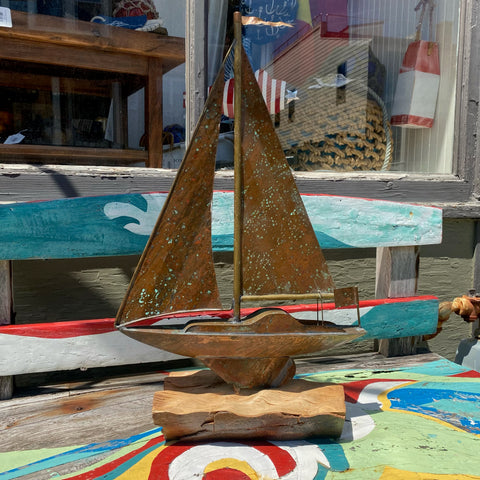 Vintage Copper Sailboat on Wood