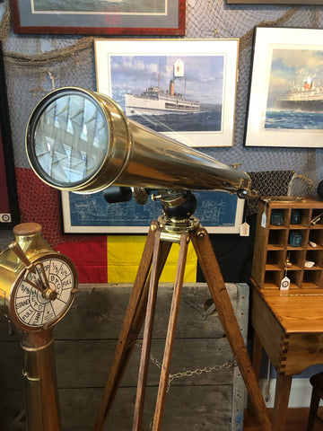 Large brass telescope on wooden tripod