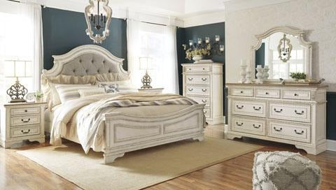 Ashley Realyn queen bedroom set in distressed antique white wood in stock at Schleider Furniture and Mattress Company in Brenham Texas