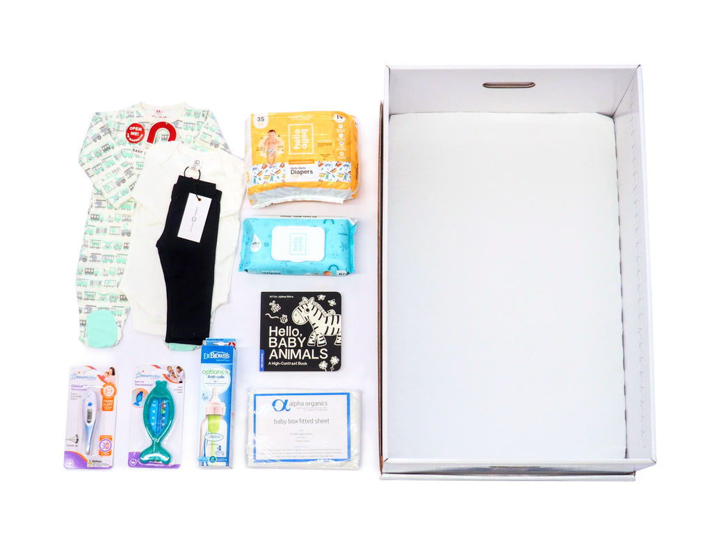 This baby box includes baby essentials like diapers, wipes, magnetic footie, colored organics onesie and baby pants, bottle, bath thermometer, digital thermometer for baby and a fitted sheet. It's the perfect gift for a baby shower.
