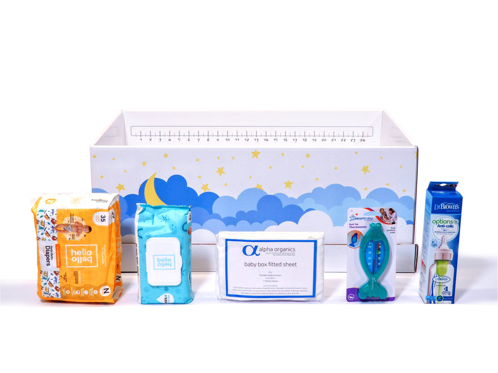 Baby diapers, wipes, bath thermometer and bottle that come included in the Finnbin baby box