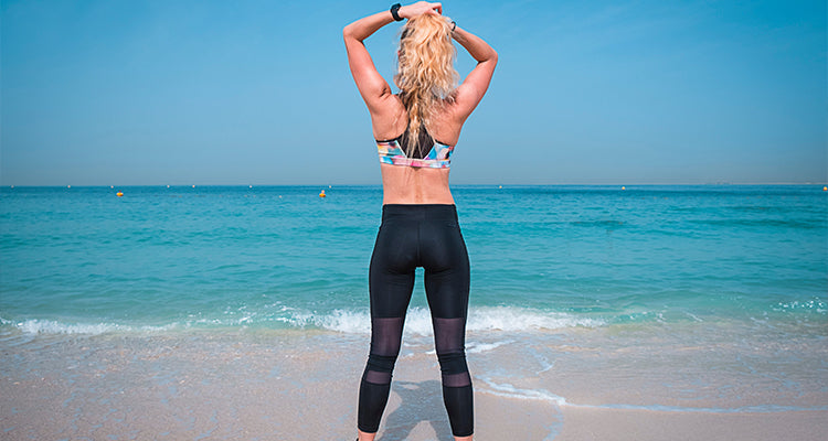 woman wearing leggings on a beach