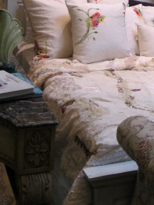 custom bed cover and pillows made with hand embroidered and hand painted fabrics by Sara Palacios