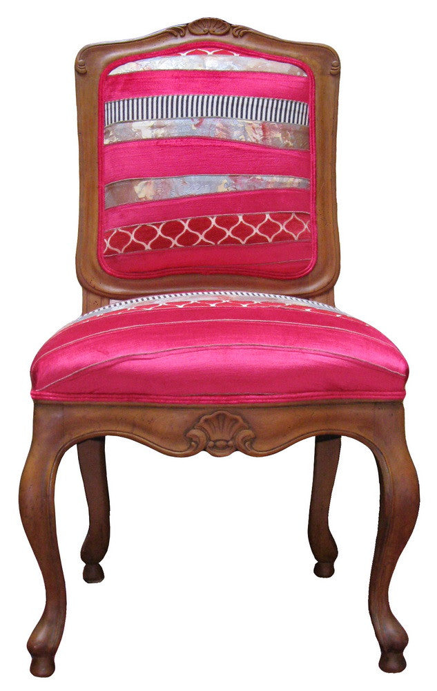 Dining chairs upholstered in Sara Palacios Designs