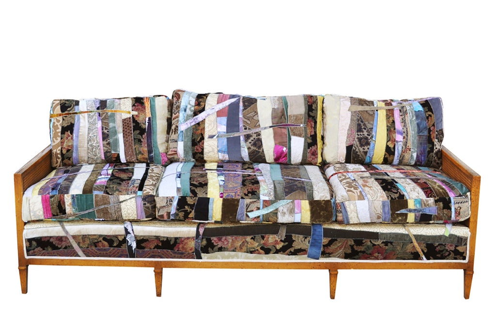 Custom sofa upholstered in patchwork fabric by Sara Palacios Designs