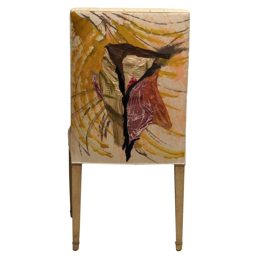 accent chair upholstered in a collage of hand painted fabrics by Sara Palacios