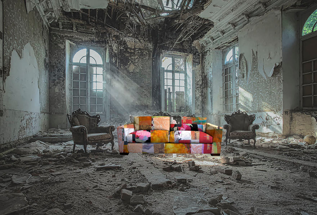 an abandon building with a patchwork couch by Sara Palacios