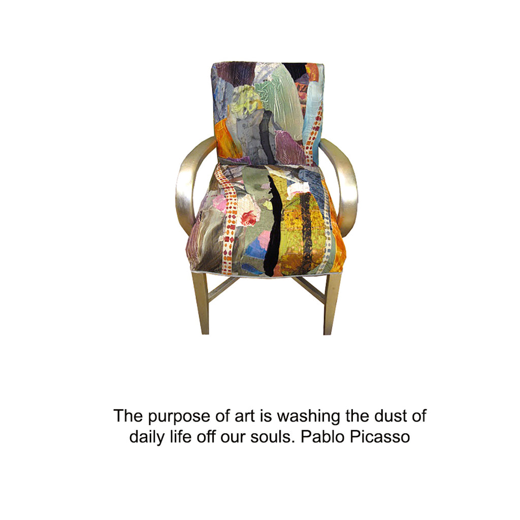blue patchwork upholstered chair with a quote from Picasso