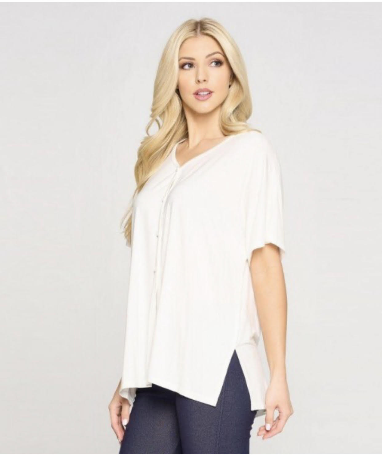 Casual Top Features a V-Neck, Four Front Button-Up Closure, Dolman Style Sleeves, and a Front Slit