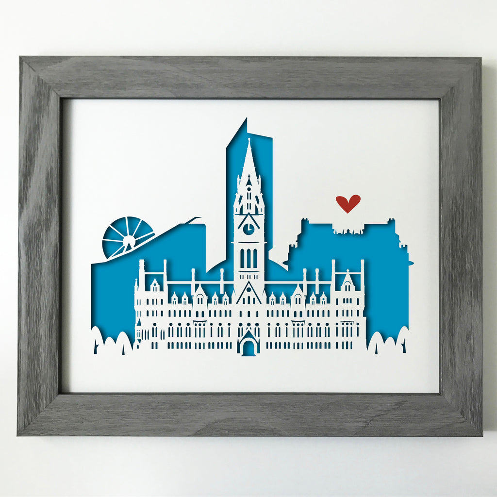 This cutout cityscape of Manchester highlights the Manchester Town Hall, with Urbis,the Beetham Tower, John Rylands Library, and the Wheel of Manchester.