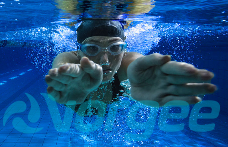Swimmer in a pool with clear goggles