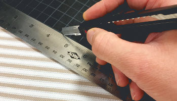 Dapper Notes Cutting fabric on an Alvin healing mat