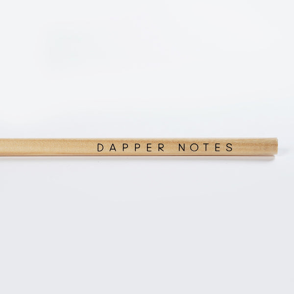 Closeup of the imprint of the Dapper Notes triangle barrel natural pencil