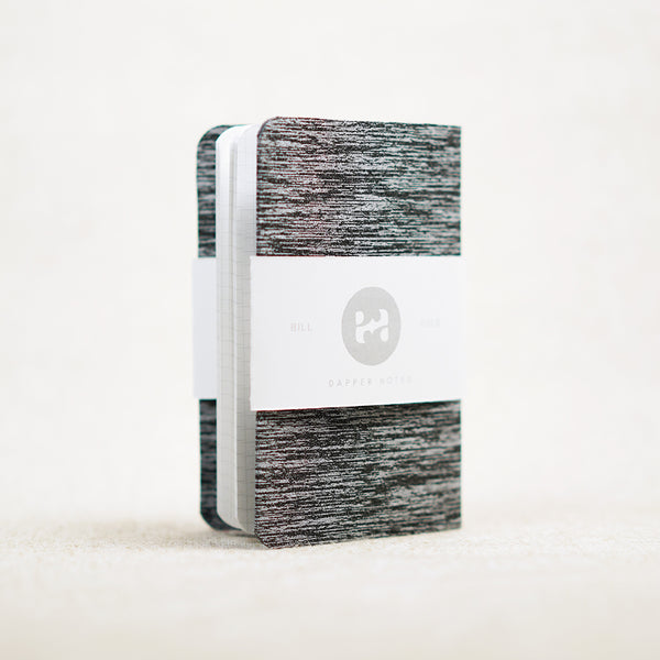 gray and white pocket notebook cover