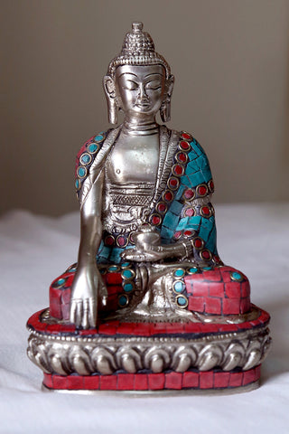 Buddha mediating in Silver finish