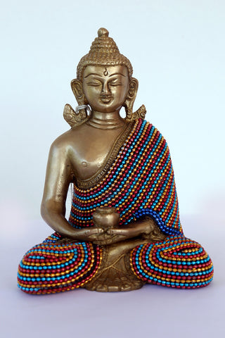Buddha meditating with bead work