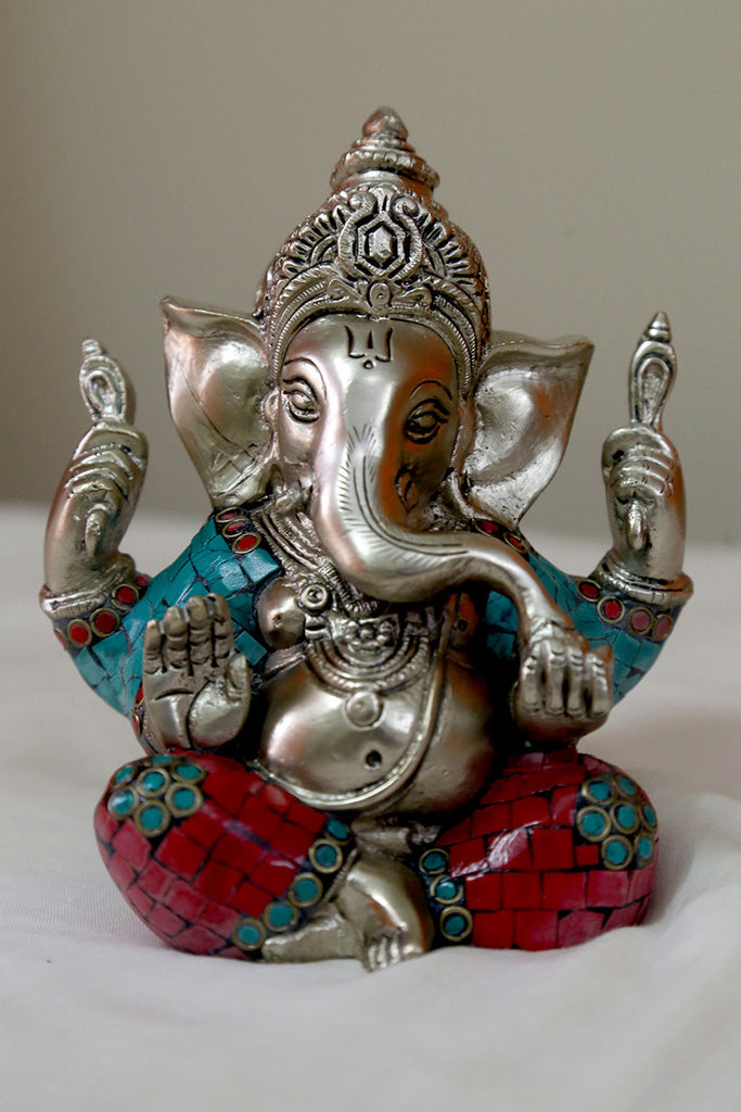 Ganesha sitting in Brass
