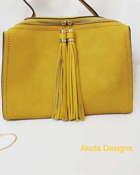 Mustard handbag and gold bracelet
