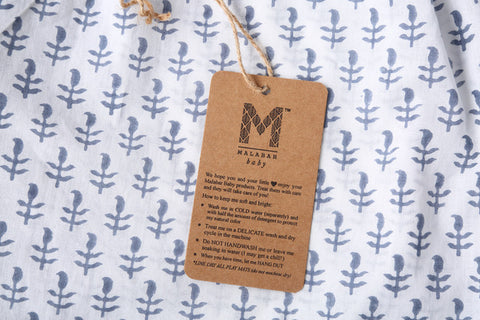 The wash care label on Malabar Baby's pajamas and loungewear