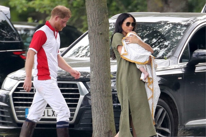 Duchess of Sussex Meghan carries baby Archie in a Malabar Baby blanket, while Prince Harry follows behind