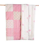 A luxuriously soft and hypoallergenic cotton voile handmade baby crib quilt. Reversible Kantha stitched Design. Pink and white Patchwork.
