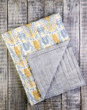 A luxuriously soft and hypoallergenic cotton voile handmade baby crib quilt. Reversible Kantha stitched Design. Grey and yellow Patchwork.