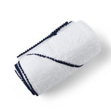 malabar baby's silky soft bamboo cotton hooded baby and toddler towel. Shown in navy blue. The towel has a detailed pom pom trim. Perfect for bath time and the pool/beach.