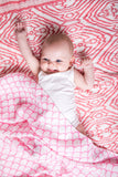 Malabar baby's 100% GOTS certified organic cotton super soft baby swaddle. Swaddle gets softer after every wash. The perfect newborn and baby shower gift. This swaddle has a beautiful pink and white rainbow design. It's stunning and gender neutral. The perfect baby shower gift.
