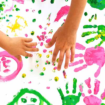 Kids handprinting with paint