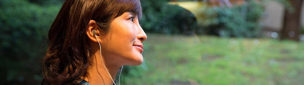 Japanese jazz singer Karen Aoki wearing Meze Headphones