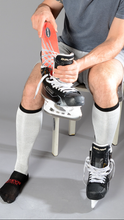 Load image into Gallery viewer, Man putting Ortema Orthopaedic Sport Insole in skates