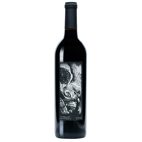 750ml bottle of 2017 Cabernet Sauvignon. Bottle is black with black foil. Label is of a gnarled branch in black and white.