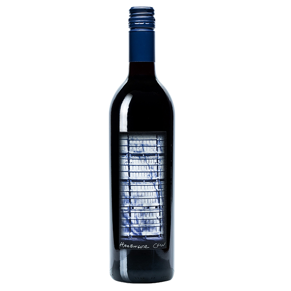 750ml bottle of 2017 Harbinger. Black bottle with a blue corkscrew cap. Label depicts a close shot of wine barrels.