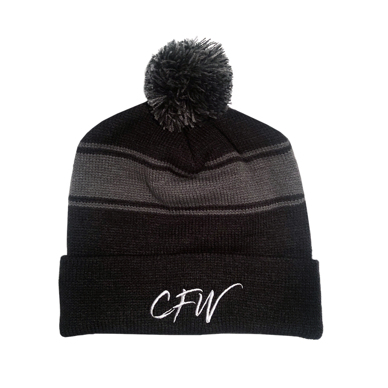 Black Chaddsford beanie with a gray pom pom at the top. CFW is embroidered in white