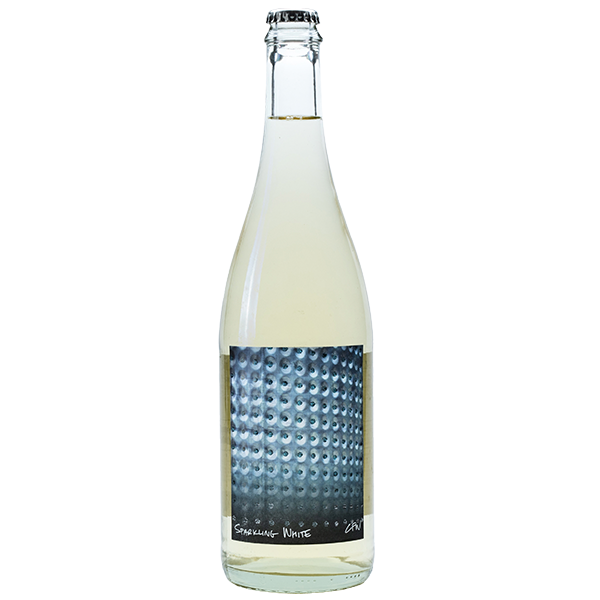 750ml bottle of 2018 Sparkling White. Clear bottle with silver cap. Label showcases close shot of tanks on the property.