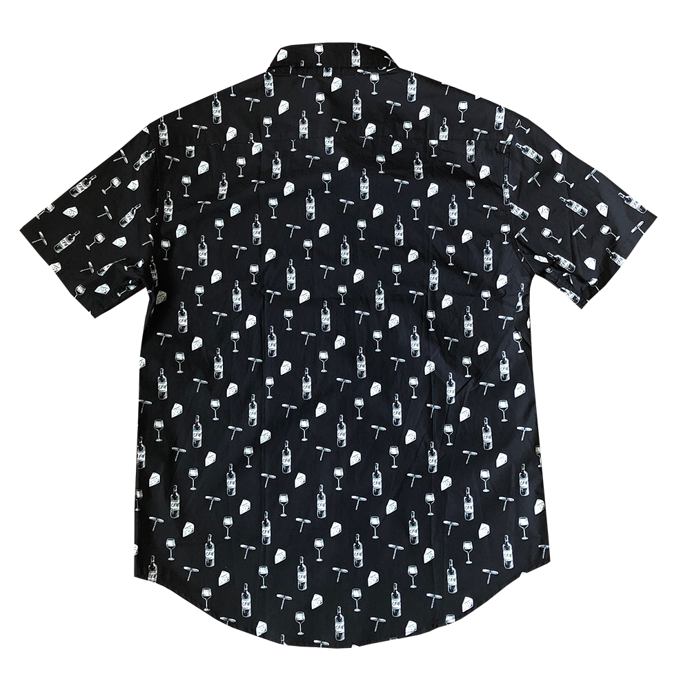 back of men's button up black shirt with white design pattern of cheese blocks, wine bottles, wine openers and glasses of wine