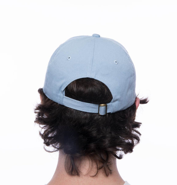 Back image of a person wearing a sky blue hat with DET embroidered on the front.